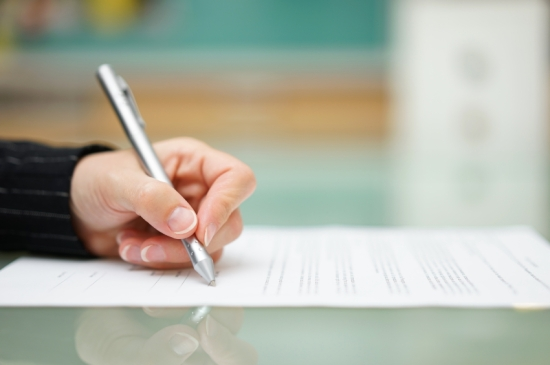 woman is filling document on glass table, shallow depth of field
