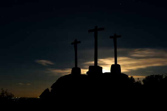 old crosses of stone to the backlight